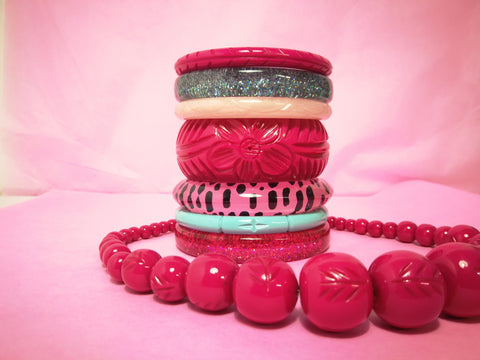 Splendette vintage inspired 1950s style fakleite pink and lagoon green stack of bangles