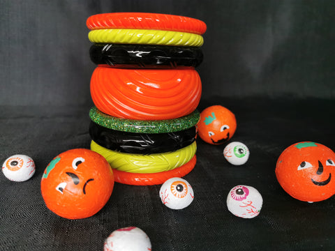 Splendette vintage inspired Halloween stack of orange, green and black fakelite bangles