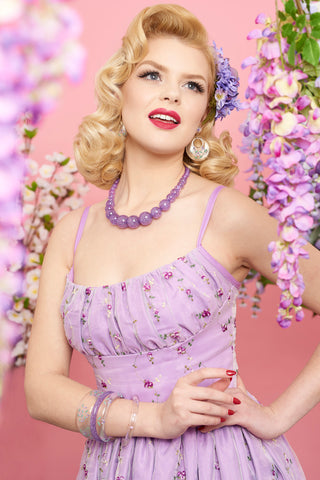 Splendette vintage inspired 1950s style floral purple lilac lavendar glitter photoshoot with Rachel Frances