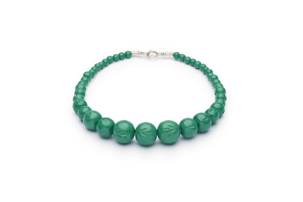 Carved Malachite Fakelite Beads