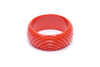 1950s style papaya orange heavy carve wide bangle