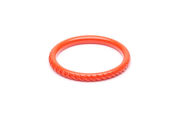 1940s style papaya orange heavy carve narrow bangle
