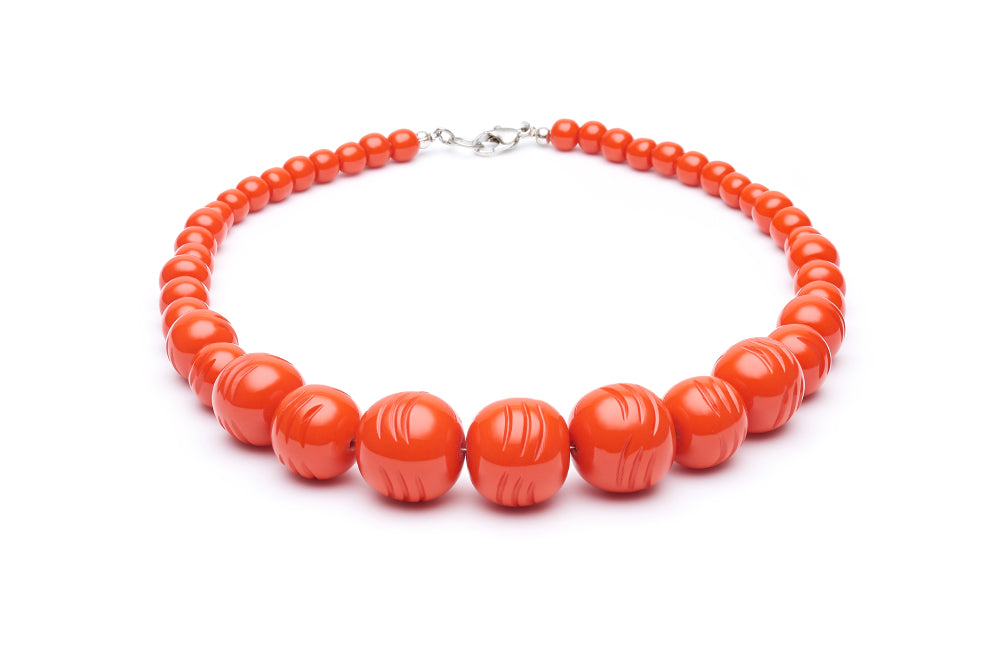 1950s style papaya orange heavy carve beads