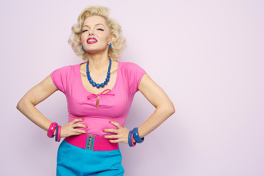 Marilyn Monroe Lookalike Suzie Kennedy in Blue and Pink Fakelite