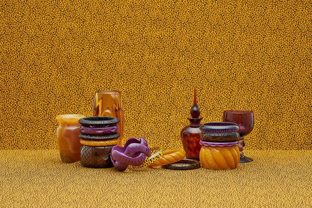 Splendette vintage inspired 1940s style display of Golden fakelite carved bangles including purple Plum, yellow Mustard, and brown Espresso with retro home glass accessories