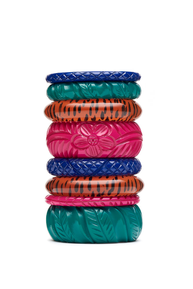 1940s style stack of nine fakelite bangles in blue jade pink leopard