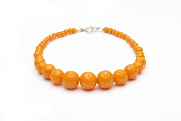 Carved Pale Orange Fakelite Beads