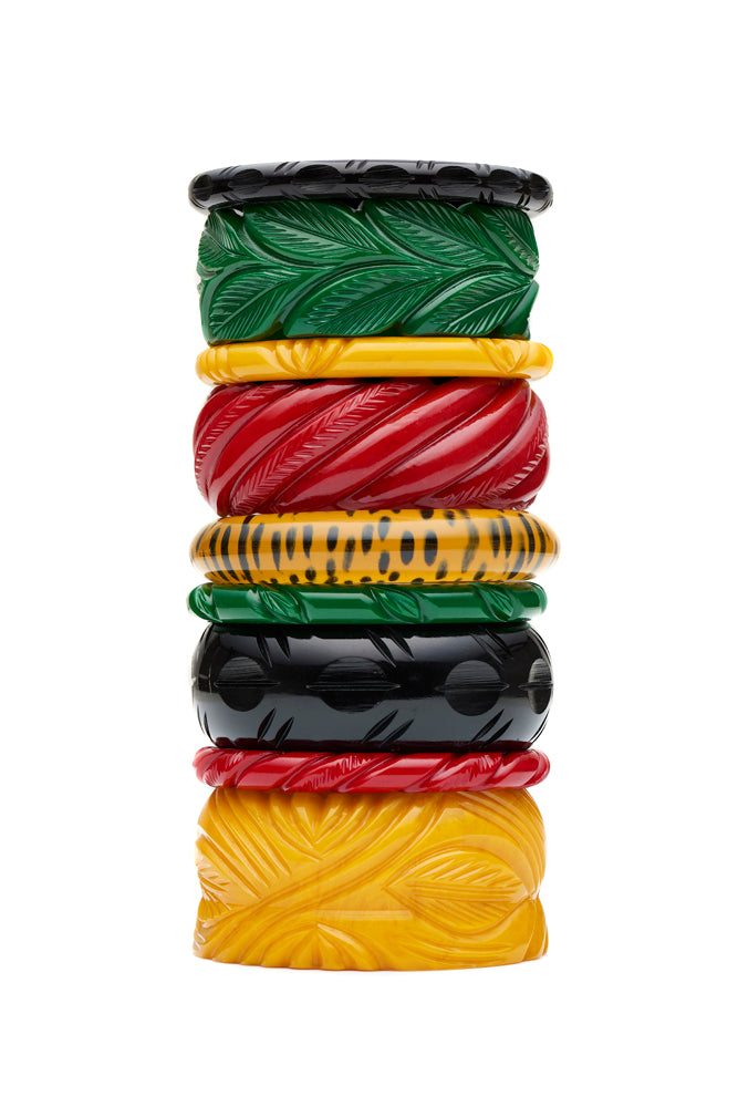 1940s style bangle stack in heavy carved colours
