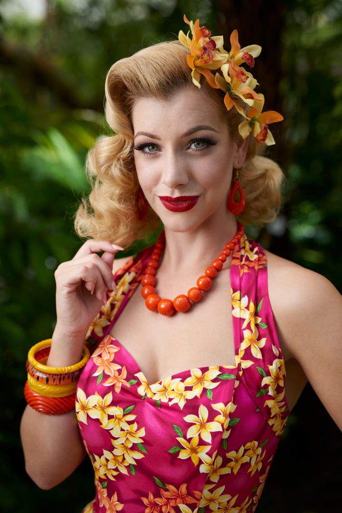 1940s fashion model shot wearing heavy carve bakelite style bangles