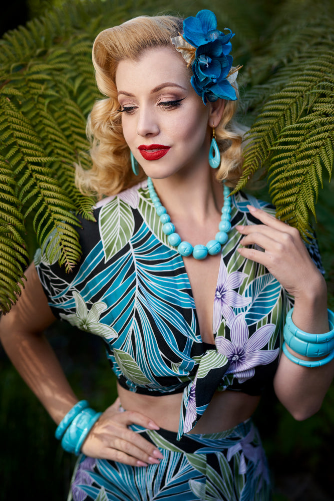 1940s fashion model shot wearing Humanitea turquoise bakelite style bangles