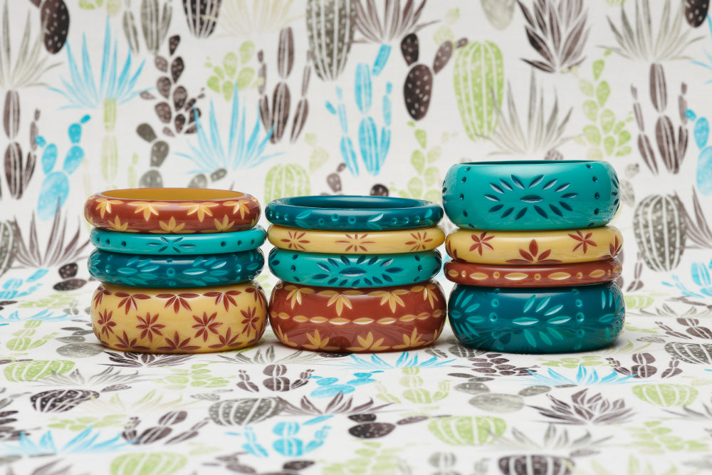Splendette vintage inspired 1950s style carved Duotone fakelite bangles in three stacks with turquoise and teal Dragonfly & Nymph, and brown and cream Café & Lait