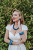 Splendette vintage inspired 1950s style Spring 2021 Blossom & Buttercups model shoot blue Duotone carved fakelite Cornflower and Forget-Me-Not jewellery
