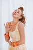 Splendette vintage inspired 1950s pin up style yellow and peachy orange carved Duotone Spring 2021 jewellery worn by Blossom & Buttercups
