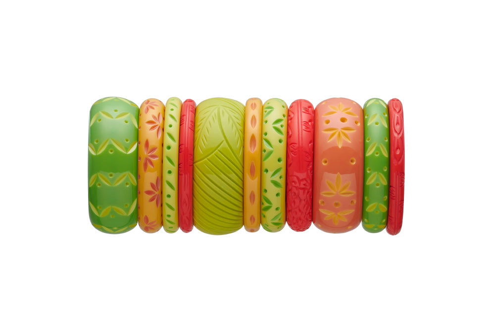 Splendette vintage inspired 1950s tropical style stack of carved fakelite bangles in green and orange. Featuring Lime, Zest, Honeysuckle, Freesia, and Coral