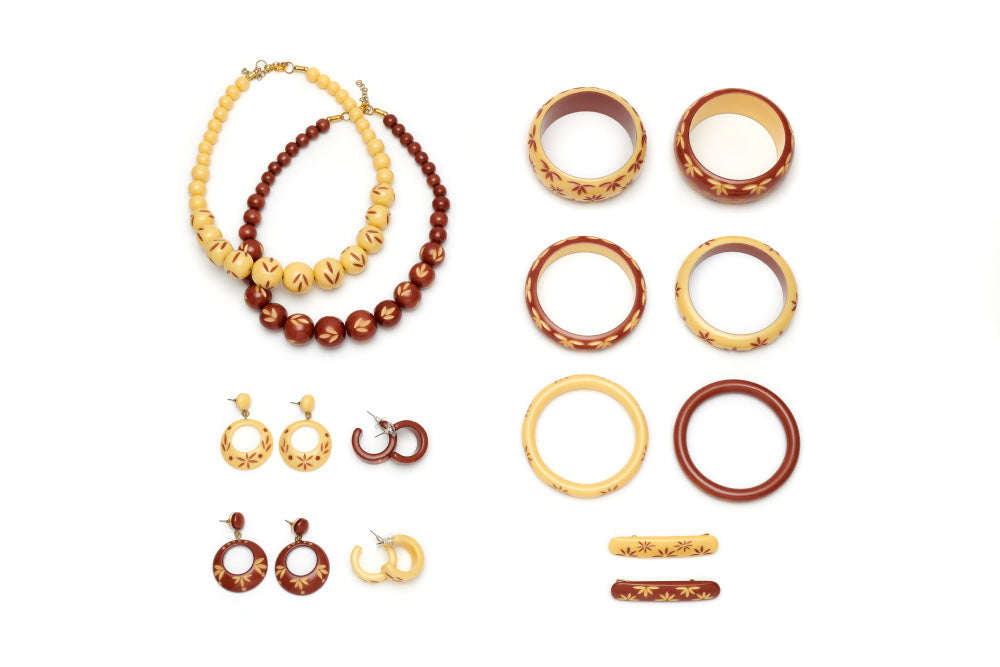Splendette vintage inspired 1950s style cream and brown carved Fakelite Duotone jewellery flat lay with bangles, earrings, hair barrettes and bead necklaces