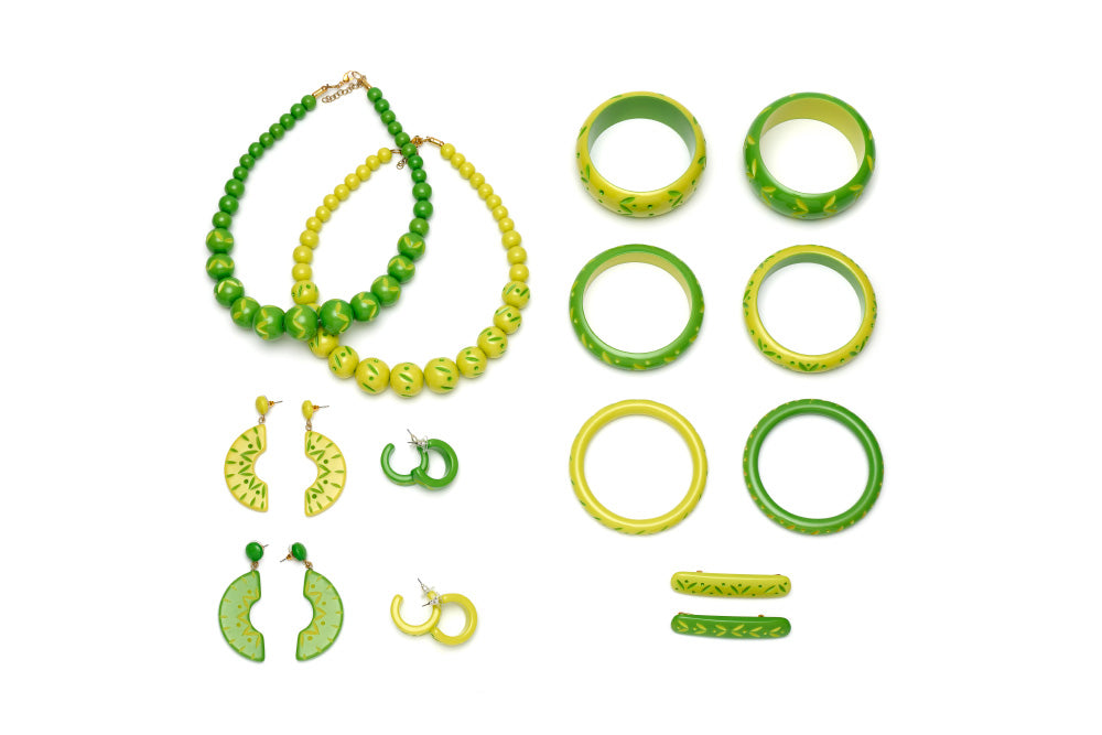 Splendette vintage inspired 1950s style Spring 2021 bright green carved Duotone fakelite jewellery flat lay with Lime & Zest