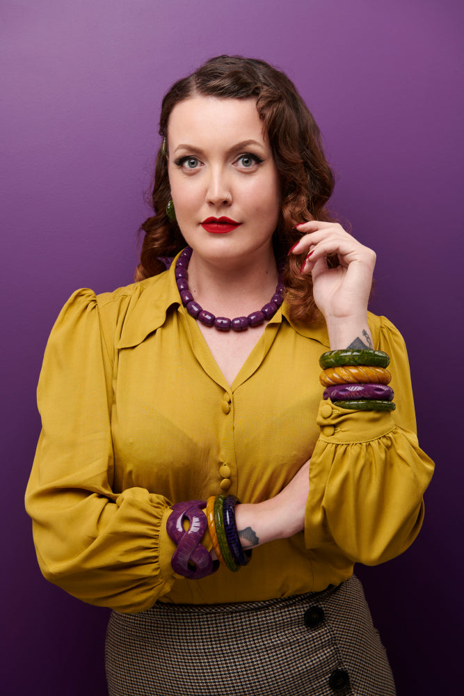 Splendette vintage inspired 1940s Bakelite style Golden Autumn model shot with fakelite jewellery. Plum, Olive and Mustard bangles with Plum necklace vertical