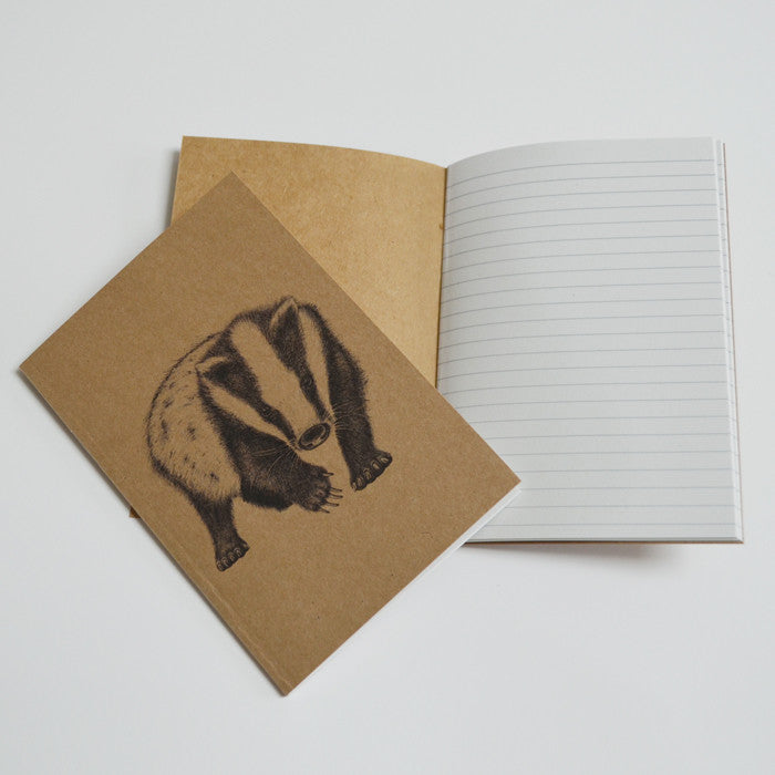 Eco-friendly notebook with badger artwork.