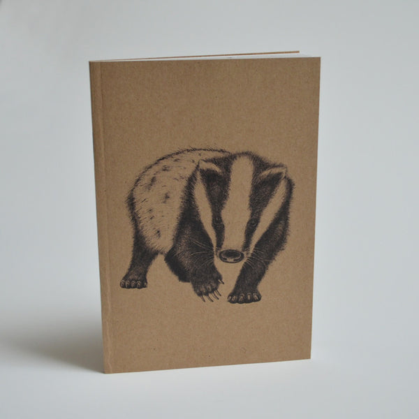Recycled notebook with badger artwork.