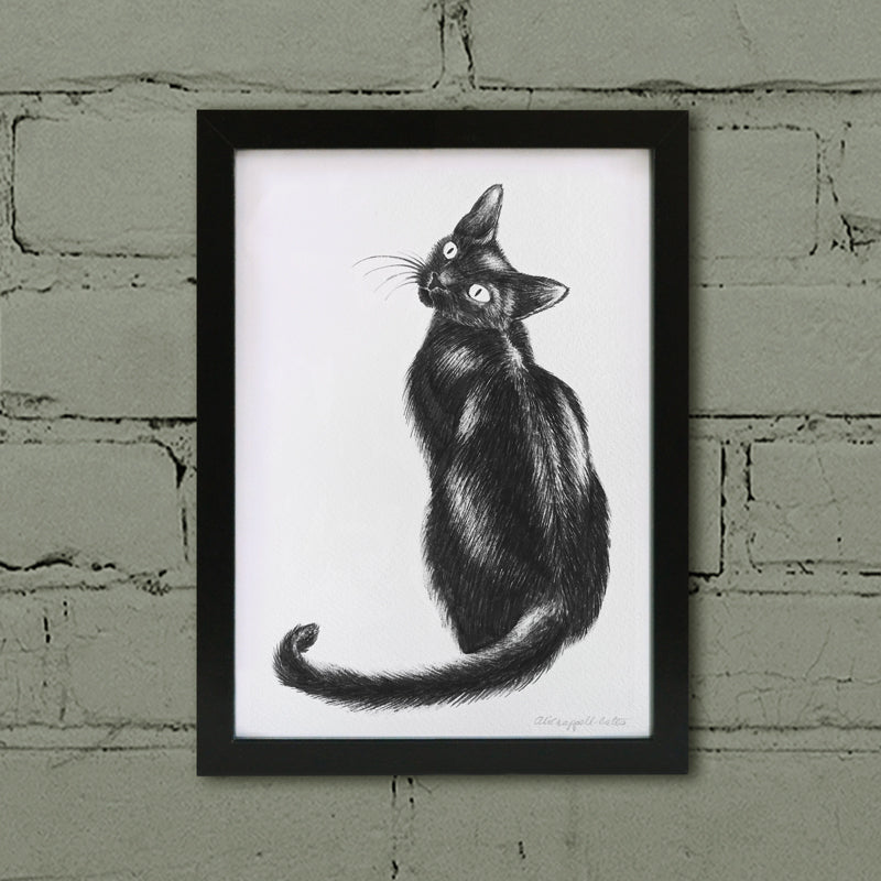 Black cat art print in frame.