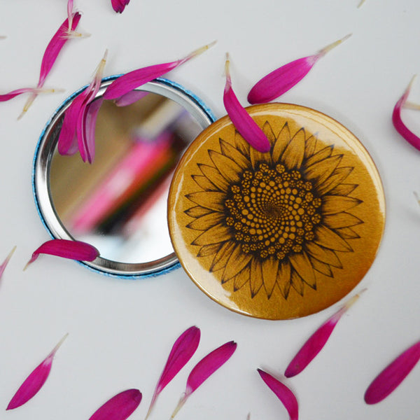 Golden sunflower pocket mirror.