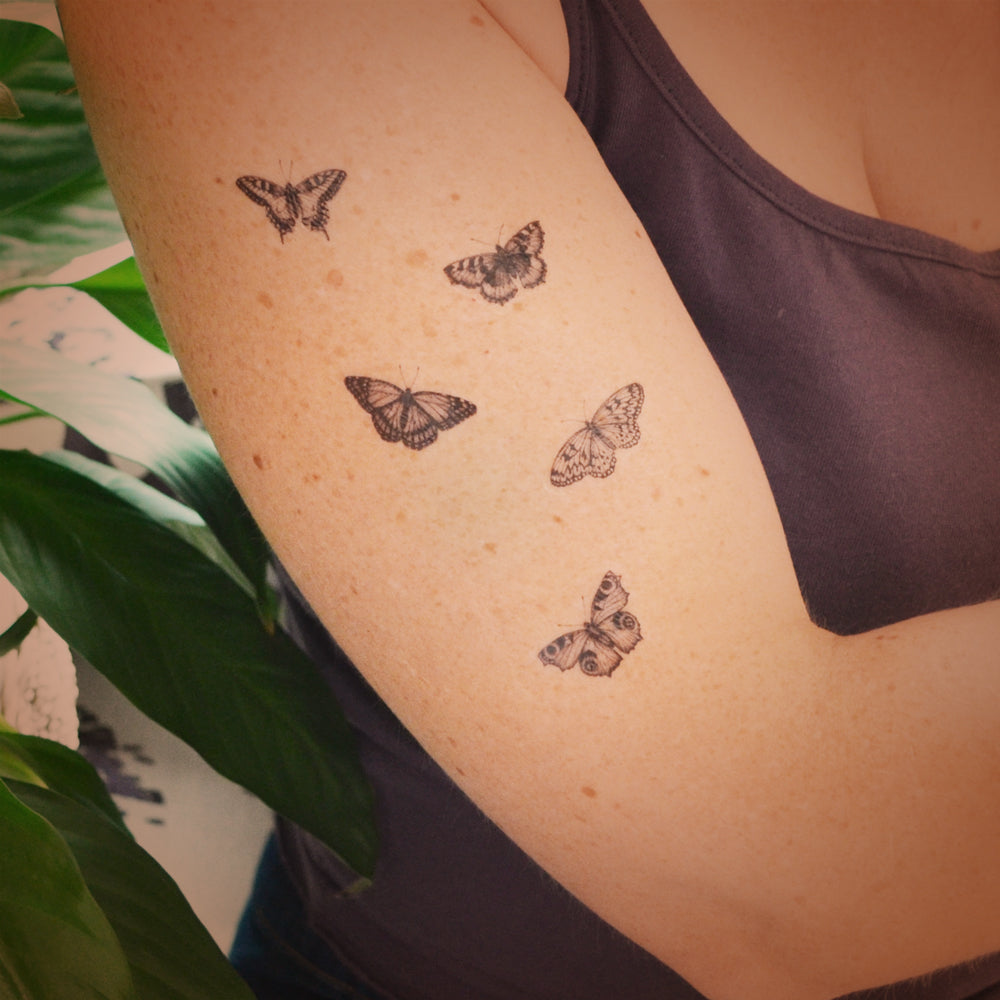 Set of five mini butterfly temporary tattoos.