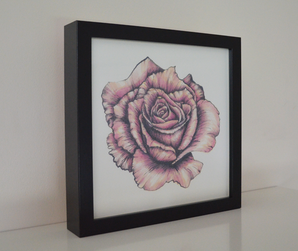 Rose art print in frame.