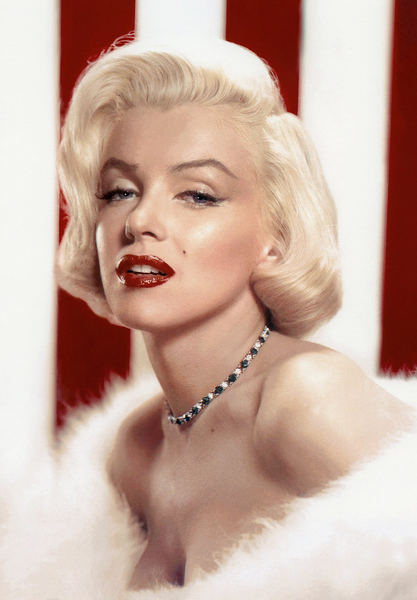 portrait of marilyn monroe wearing red lipstick, a necklace, and a white fur stole. she is in front of a red and white striped background.