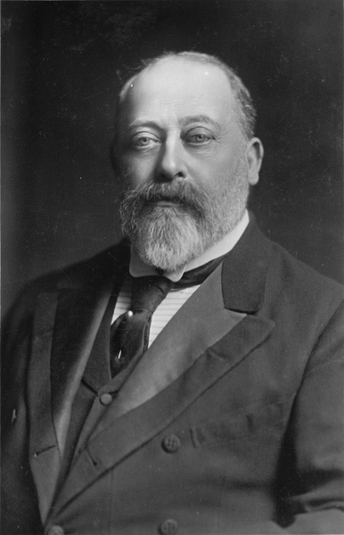 a black and white photograph if King Edward VII. he is wearing a suit.