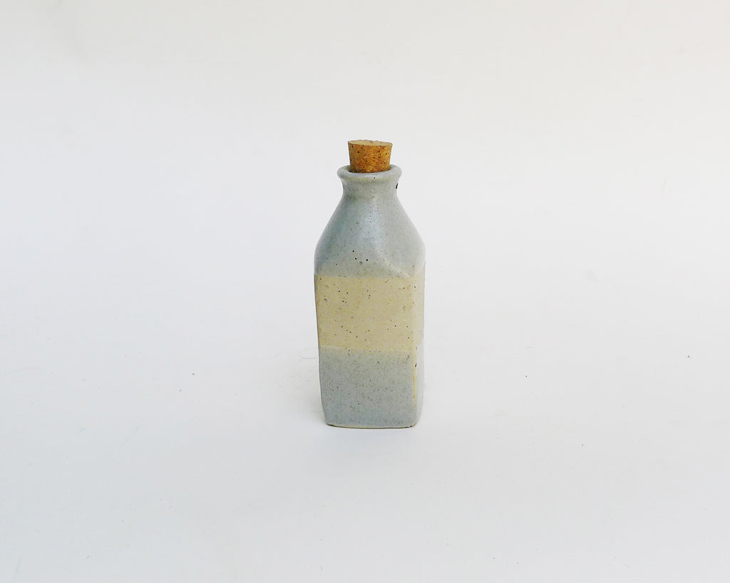 Grey and White Bottle