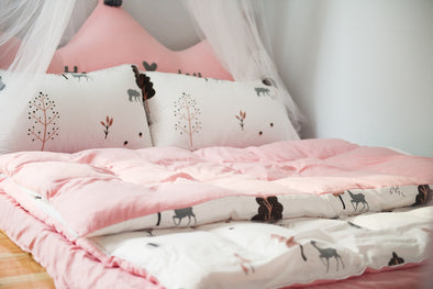 Soft bedding and drapes to create a cosy space for children