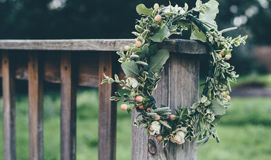 Floral hair wreath on wooden fence
