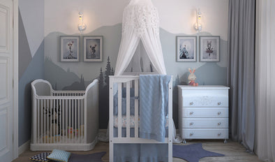 A children's bedroom with blue and white coloured painted mountains on the walls for fun kids bedroom decor ideas