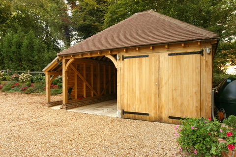 two bay oak framed garage with log store and door