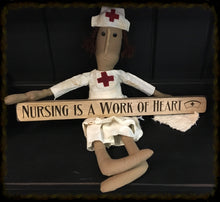 "Router Sign ""Nursing is a Work of Heart""."