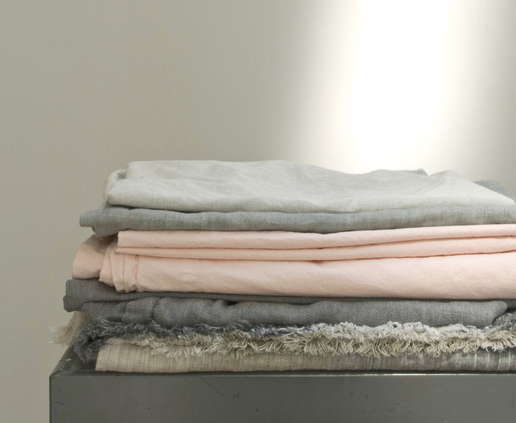 how to care for your linens stack of linens