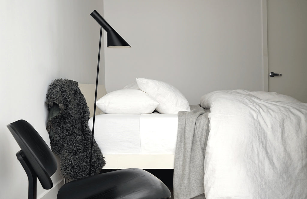 ELI white linen cotton blend basketweave sheets with black lamp and chair