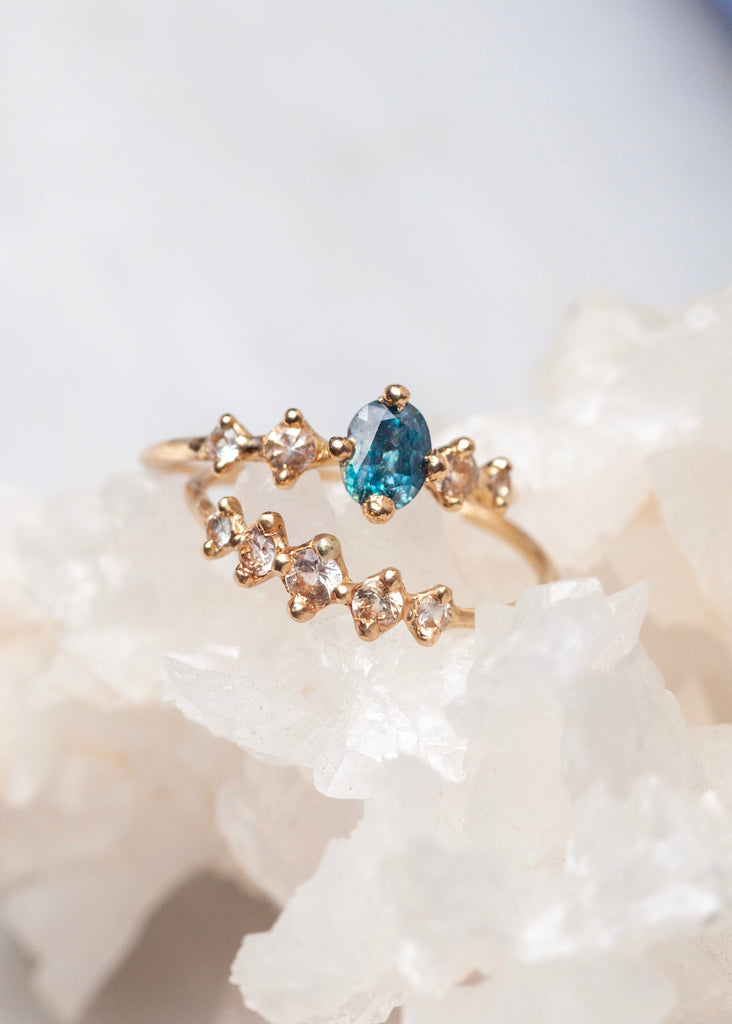 teal blue montana sapphire ethical engagement rings in 14k fairmined gold