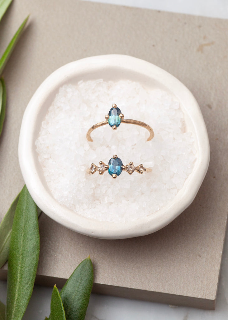 teal blue montana sapphire rings in 14k fairmined gold