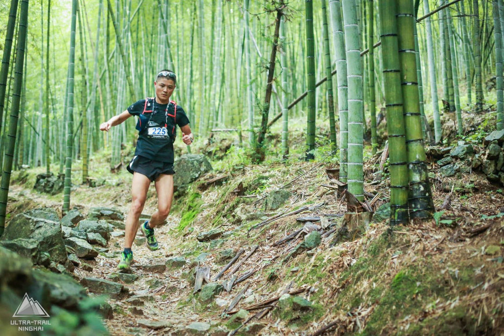 Trail runner in a bamboo forest in Ninghai, China