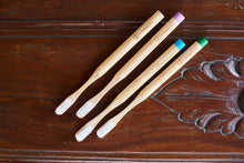 Four bamboo toothbrushes in different colours