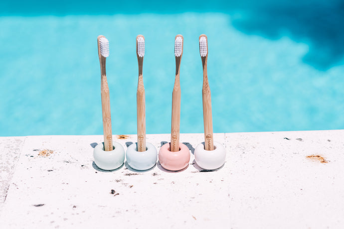 Four of BAMWOO's ceramic toothbrush holders