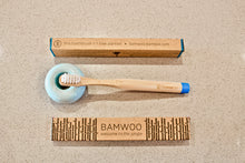 BAMWOO children's bamboo toothbrush in ocean blue with blue ceramic toothbrush holder