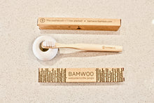 BAMWOO children's bamboo toothbrush in natural with white ceramic toothbrush holder
