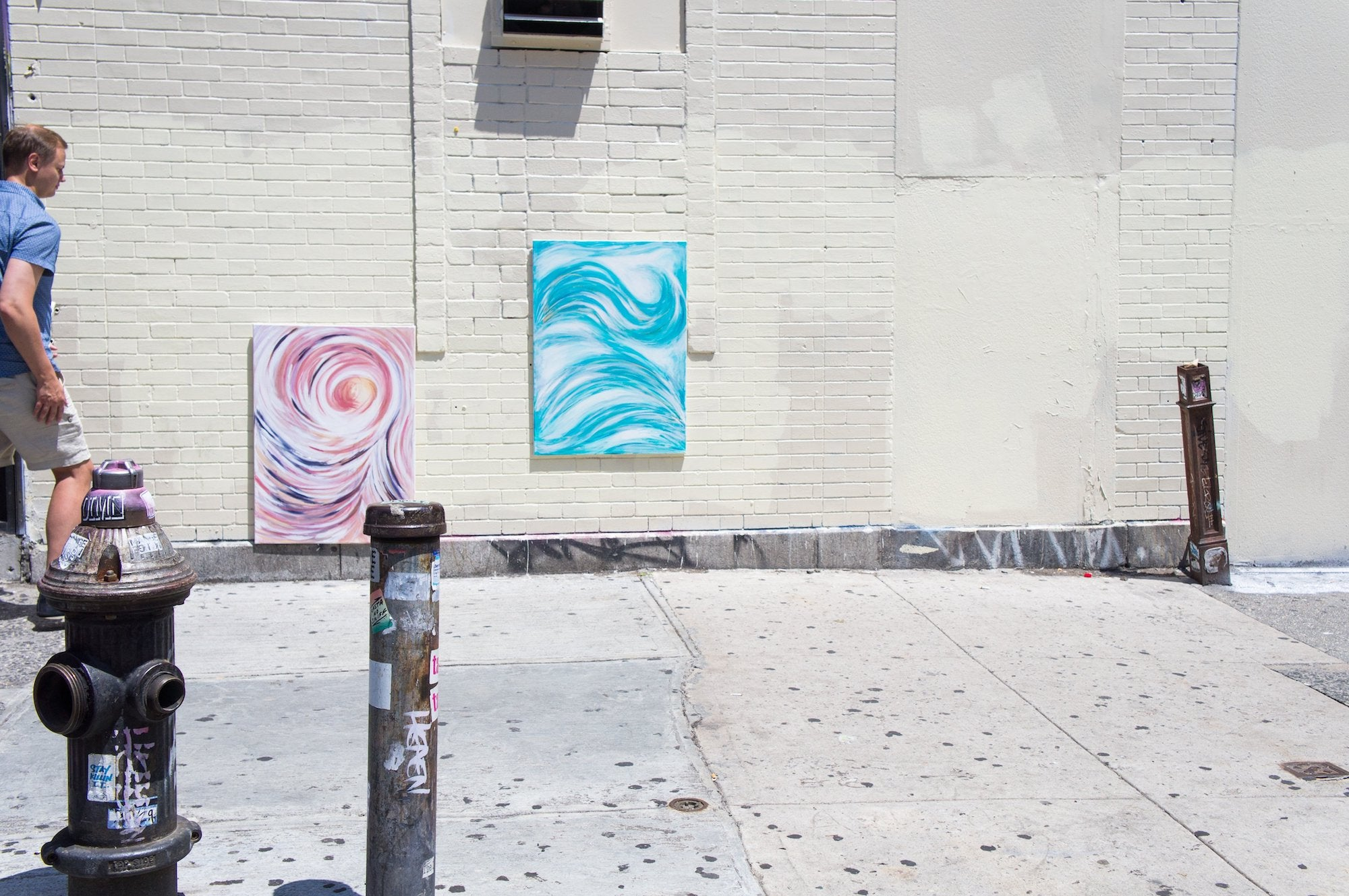 paintings by a wall in Lower East Side