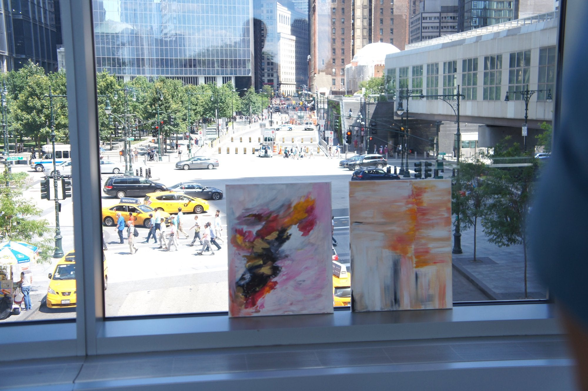 paintings by a glass window
