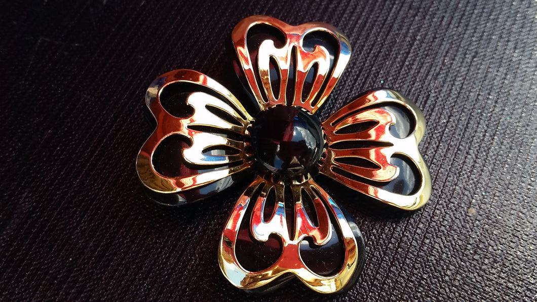 Black and gold layered tin flower brooch