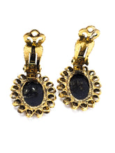 Black Glass reversed carved cameo clip on vintage earrings mid century