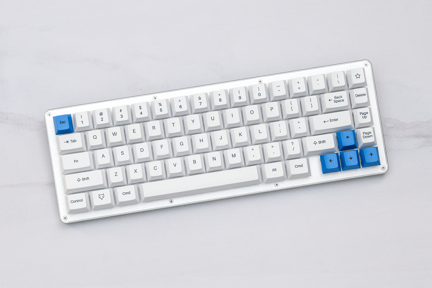 WhiteFox Mechanical Keyboard on a GMK Camping Keyset themed desk mat by Novelkeys