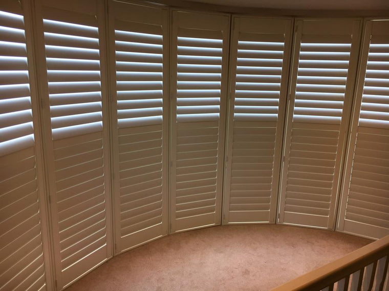 Bay window wood shutters